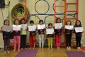 Lil' Buds proudly showing their Grade Three and Grade Four certificates and badges after achieving the grades in the Blossom Yoga Syllabus