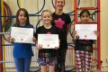 Big Buds proudly showing their Grade Two certificates and button badges after achieving the grade in the Blossom Yoga Syllabus